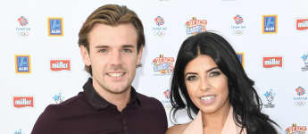 Nathan Massey and Cara de la Hoyde arrive for the Team GB FanZone Opening Ceremony Party in Queen Elizabeth Olympic Park on August 5, 2016 in London, England.