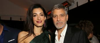 """Amal and George Clooney attend the premiere of Hulu's """"Catch-22"""" on May 07, 2019 in Hollywood, California."""