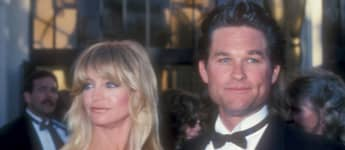Goldie Hawn and Kurt Russell on the red carpet at the 1989 Academy Awards.
