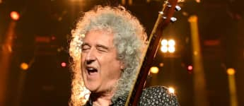 "Queen's Brian May Is Hospitalized For ""Over-Enthusiastic Gardening"" That Led To A Butt Injury"