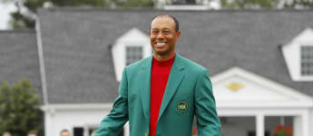 22 years after his first win at Augusta National, Tiger Woods wears the winning Green Jacket for the fifth time.