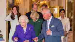 Duchess Catherine, Duchess Camilla, Prince William, Prince Harry, Queen Elizabeth II, Prince Charles and Duchess Meghan attend a reception to mark the fiftieth anniversary of the investiture of the Prince of Wales at Buckingham Palace