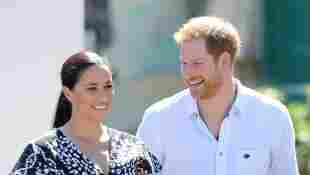 Duchess Meghan and Prince Harry laugh during a visit to The Justice Desk on September 23, 2019 in Cape Town, South Africa.