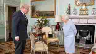 Queen Elizabeth Has Photo Of Prince Harry and Meghan Markle On Display For Boris Johnson Meeting