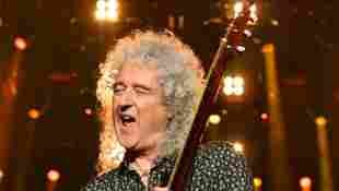 """Queen's Brian May Is Hospitalized For """"Over-Enthusiastic Gardening"""" That Led To A Butt Injury"""