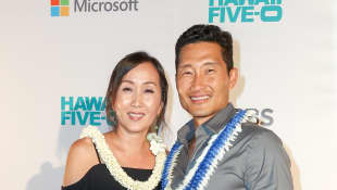 Actor Daniel Dae Kim and his wife Mia arrive at the CBS 'Hawaii Five-0' Sunset On The Beach Season 7 Premier Event at Queen's Surf Beach on September 23, 2016 in Waikiki, Hawaii