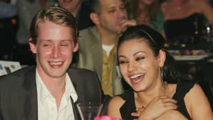 "Actor Macaulay Culkin and actress Mila Kunis attend the launch of the ""uBid for Hurricane Relief"" charity auction and benefit at the Empire Ballroom 2005"