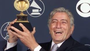 Tony Bennett holds his Grammy Award