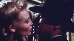 "Alison Doody and Harrison Ford as ""Dr. Elsa Schneider"" and ""Indiana Jones"" in Indiana Jones and the Last Crusade."