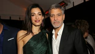 "Amal and George Clooney attend the premiere of Hulu's ""Catch-22"" on May 07, 2019 in Hollywood, California."
