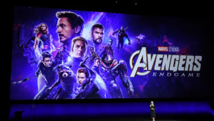 Disney Executive Cathleen Taff speaks in front of the Avengers movie poster during the 2019 CinemaCon presentation.
