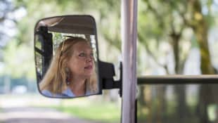 Founder Carole Baskin drives a golf cart at Big Cat Rescue in Tampa on Thursday, July 20, 2017.