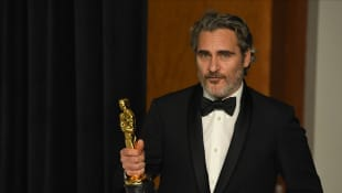 Joaquin Phoenix quoted his late brother River in a tearful Oscar speech.