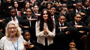Duchess Meghan poses with school children during a visit to Robert Clack School in Dagenham, March 6, 2020.
