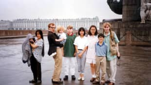 Mia Farrow and Woody Allen with their children (Satchel, Lark, Dylan, Fletcher, Daisy, Doon-Yi, and Moses in Leningrad.