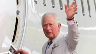 Prince Charles is flying back to England to confront his brother, Prince Andrew