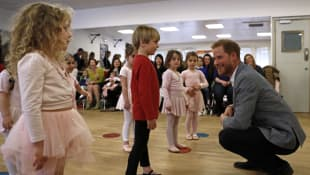 Prince Harry chats visits the YMCA South Ealing