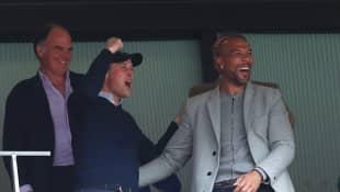 Prince William celebrates at Wembley Stadium with former Aston Villa player John Carew.