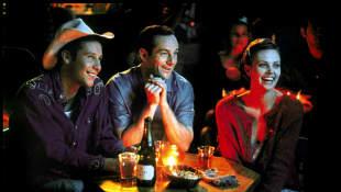 Michael Rosenbaum, Jason Isaacs and Charlize Theron
