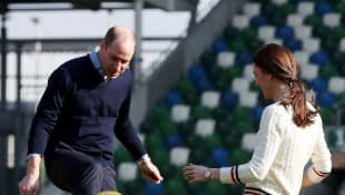 Prince William and Duchess Kate playing football in Belfast