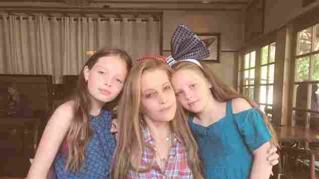 Lisa Marie Presley and her twin daughters Harper Vivienne Ann and Finley Aaron Love