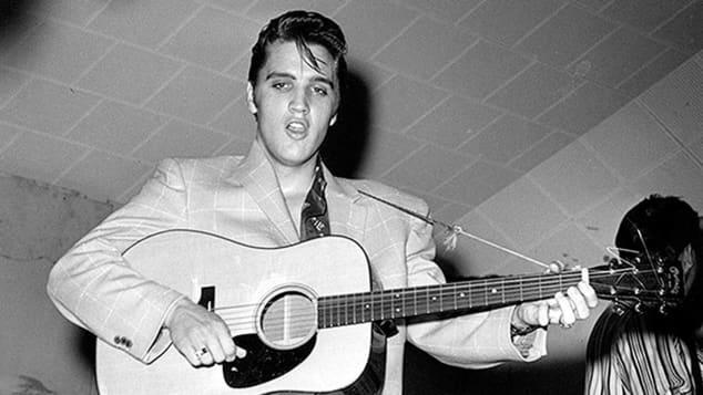 Elvis Presley performing.