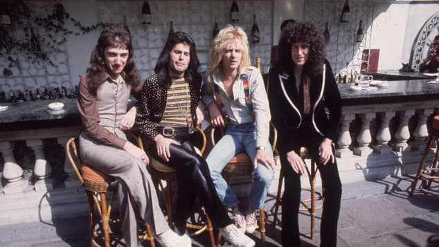 British rock group Queen at Les Ambassadeurs, where they were presented with silver, gold and platinum discs for sales in excess of one million of their hit single 'Bohemian Rhapsody'