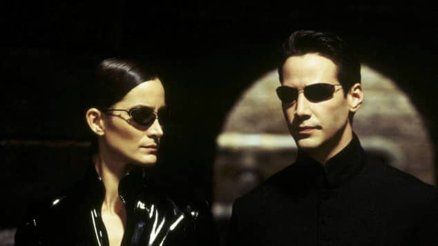 """Carrie-Anne Moss (""""Trinity"""") and Keanu Reeves as """"Neo"""" in the 1999 worldwide hit The Matrix."""