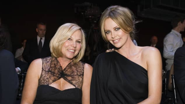 Charlize Theron (R) and her mother Gerda Theron attend the Dior 2008 Cruise collection fashion show on May 14, 2007 in New York City