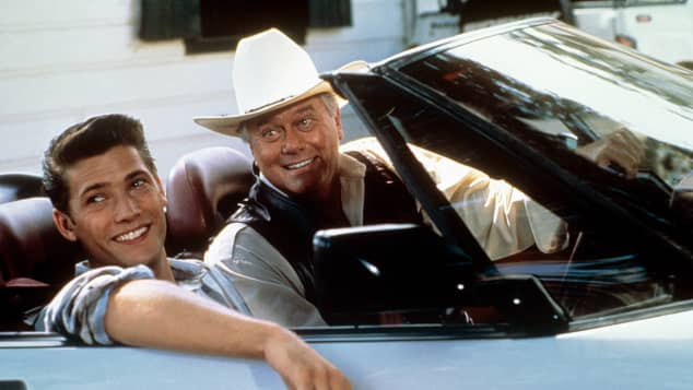 "Sasha Mitchell and Larry Hagman starred in the series, ""Dallas"""