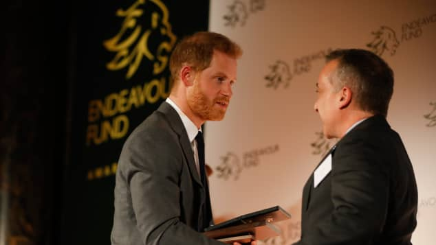 Prince Harry presents the The Henry Worsley Award to Shaun Pascoe, a former officer with the RAF Medical Emergency Response Team (MERT), at the Endeavour Fund awards