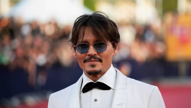 "ohnny Depp poses on the red carpet as he arrives for the screening of the movie ""Waiting for the Barbarians"" at the 45th Deauville US Film Festival on September 8, 2019."