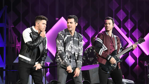 Nick Jonas, Joe Jonas, and Kevin Jonas of Jonas Brothers perform during Power 96.1's Jingle Ball 2019 in Atlanta