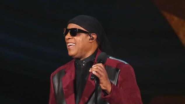 Stevie Wonder performing on stage