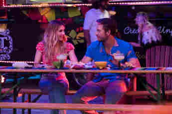 "Emma Roberts as ""Sloane Reed"" and Luke Bracey as ""Jackson""."