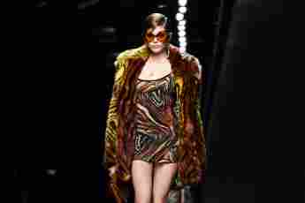 Kaia Gerber presents a creation for Versace' Women Fall - Winter 2020 fashion collection during Milan Fashion Week