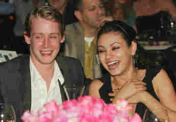 """Actor Macaulay Culkin and actress Mila Kunis attend the launch of the """"uBid for Hurricane Relief"""" charity auction and benefit at the Empire Ballroom 2005"""