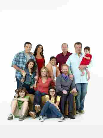`The cast of Modern Family poses with the Screen Actors Guild Award for Oustanding Performance by an Ensemble in a Comedy Series