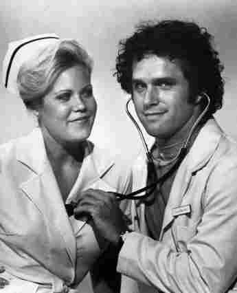 """Christopher Norris and Gregory Harrison as """"Gloria 'Ripples' Brancusi"""" and """"Dr. George Alonzo 'Gonzo' Gates""""."""