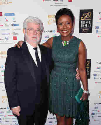 George Lucas and his wife Mellody Hobson on the red carpet.