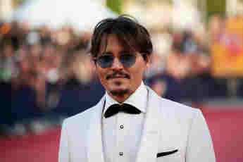 """ohnny Depp poses on the red carpet as he arrives for the screening of the movie """"Waiting for the Barbarians"""" at the 45th Deauville US Film Festival on September 8, 2019."""