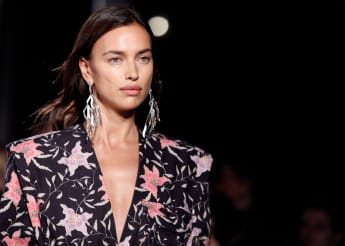 Irina Shayk presents a creation by Isabel Marant during the Women's Spring-Summer 2020 Ready-to-Wear collection fashion show, at the Jardin du Palais Royal, in Paris, on September 26, 2019