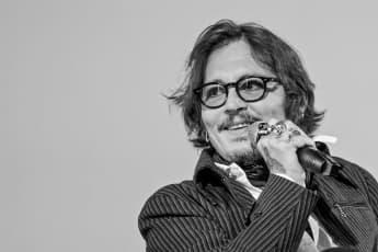 Johnny Depp Accepts Award In A Photo Of Him Behind Bars Following Libel Case Loss