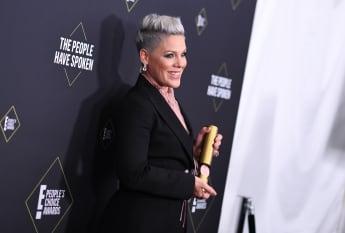 Pink poses with the Peoples Champion Award during the 45th annual E! People's Choice Awards.