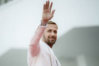 """Ryan Gosling waves as he arrives for the opening ceremony and the premiere of the film """"First Man"""", presented in competition at the 75th Venice Film Festival on August 29, 2018"""