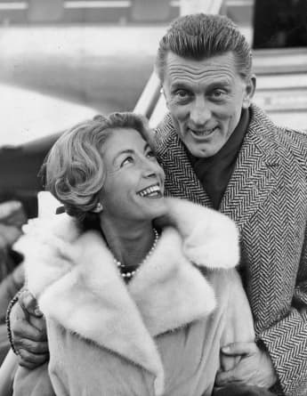 5th December 1960: Kirk Douglas and his wife Anne Budyens arriving in London for the premiere of his new film, 'Spartacus'.