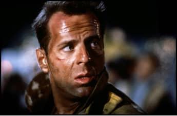 """Bruce Willis as """"John McClane"""" in Die Hard."""