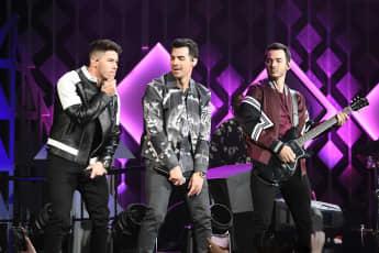 Nick Jonas, Joe Jonas, and Kevin Jonas of Jonas Brothers perform during Power 96.1's Jingle Ball 2019 in Atlanta