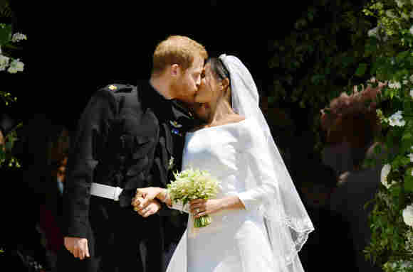 Prince Harry and Meghan Markle kiss on the steps of St George's Chapel in Windsor Castle after their wedding in St George's Chapel at Windsor Castle on May 19, 2018.
