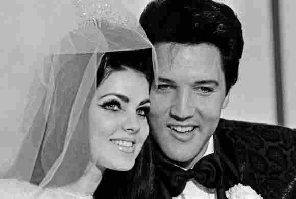 Priscilla Presley and Elvis Presley on their wedding day